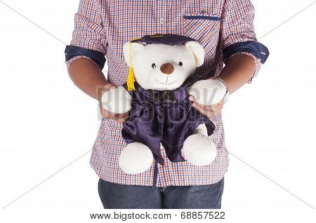 man giving teady bear with graduation hat to someone