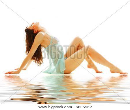 Slender Beautiful Woman Sitting
