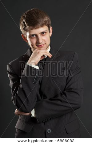 Smiley Businessman In Black Suit