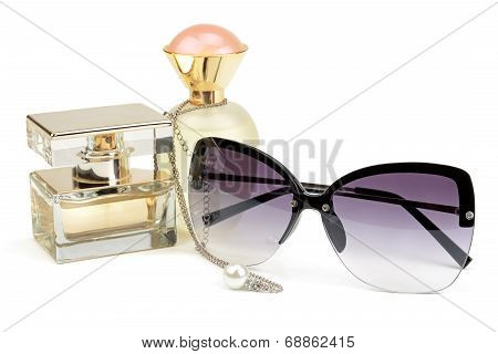 Perfume Bottles, Sunglasses And Chain