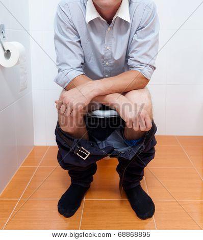 Businessman In Toilet