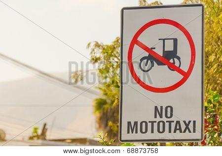 MOLLENDO, PERU, MAY 20, 2014 - Traffic sign prohibiting mototaxi driving