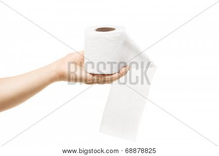 Female hand holding a roll of toilet paper isolated on white background