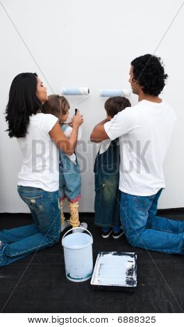 Attentive Parents Helping Their Children Paint