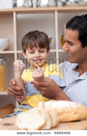 Father And Son Cutting Bread