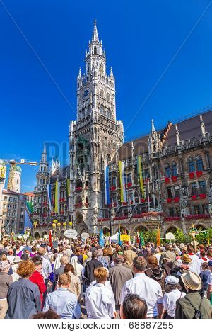 MUNICH, GERMANY - 19 JUNE 2014: People at the New Town Hall on the Feast of Corpus Christi,  Munich, Germany. The New Town Hall built between 1867 and 1908 represents Gothic Revival architecture style