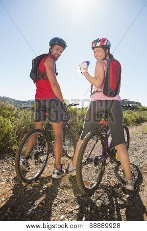Active couple cycling in the countryside on a sunny day