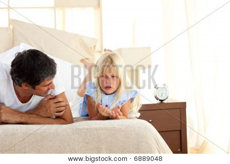 Attentive Father Talking With His Daughter