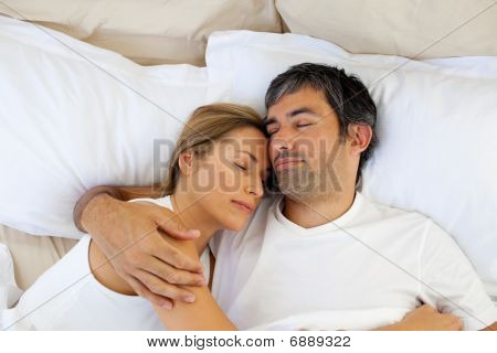 Caring Lovers Sleeping Lying In The Bed