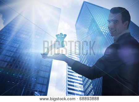 Composite image of businessman holding business man in swivel chair against low angle view of skyscrapers