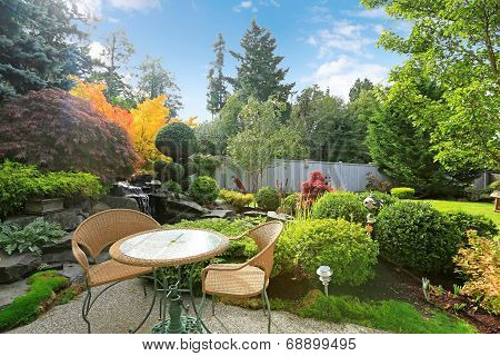 Home Tropical Garden With Wicker Table Set