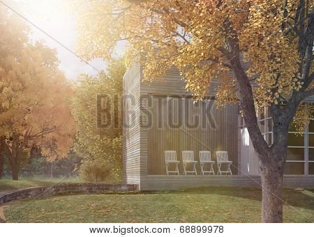 Modern apartment or office block amongst trees in a landscaped garden under a hot summer sun with sun flare
