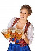 stock photo of traditional dress  - Young sexy Oktoberfest woman wearing a traditional Bavarian dress dirndl serving beer mugs - JPG