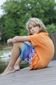 picture of dock a pond  - young teen sitting around on the dock waiting - JPG