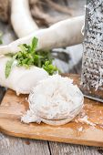 stock photo of grated radish  - Fresh grated Horseradish on wooden background (detailed close-up shot)