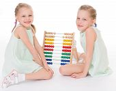 pic of montessori school  - Cute sisters work in the Montessori environment - JPG