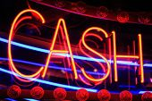foto of arcade  - Red cash neon sign at night at a gambling arcade - JPG