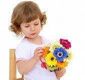 foto of coy  - Beautiful little girl with beautiful hairstyle holds a bouquet of flowers on a white background on Holiday - JPG