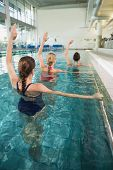 image of day care center  - Female fitness class doing aqua aerobics in swimming pool at the leisure centre - JPG