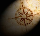 picture of cartographer  - vintage compass on old paper with stains - JPG