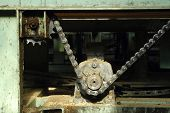 foto of interrupter  - Factory interrupted old machine gear with chain - JPG