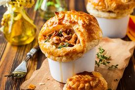 stock photo of crust  - Individual Mushroom pot pie with puff pastry crust - JPG
