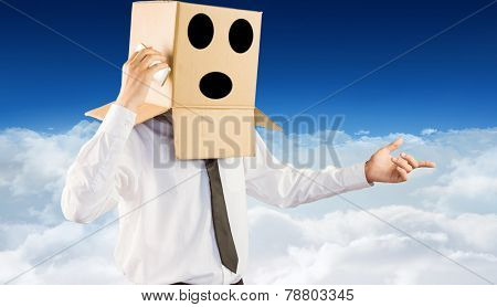 Anonymous businessman with his smartphone against bright blue sky over clouds