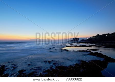 Tanah Lot Temple And Ocean Waves At Sunset