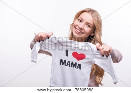 Young attractive woman holding babysuit I love mom isolated on w