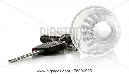 Empty glass and car key, isolated on white