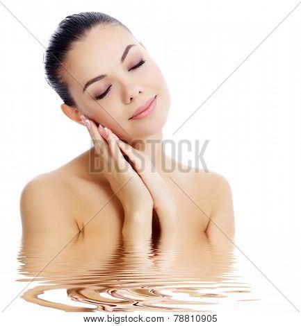 Beautiful female with clean fresh skin, white background