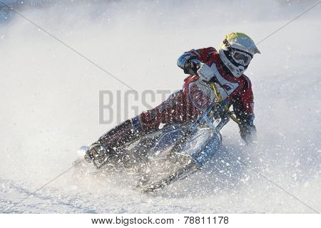 NOVOSIBIRSK, RUSSIA - DECEMBER 20, 2014: Unidentified biker during the semi-final individual rides of Russian Ice Speedway Championship. The sports returns to the sport arenas after a decline