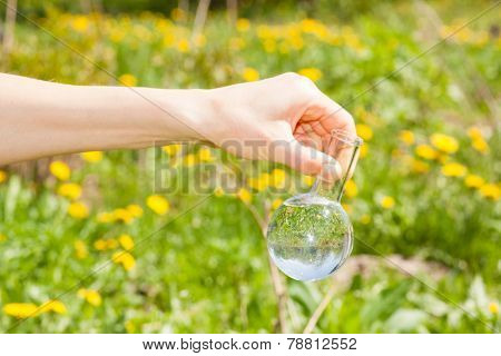 flask with clear water or fertilizer,  liquid in glassware