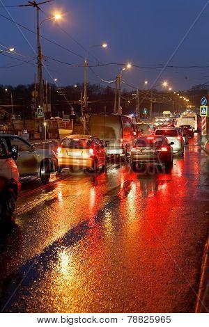 Urban Traffic In Rainy Evening