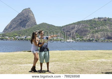 Tourist couple in Rio de Janeiro in front of the Sugar Loaf Mountain, Brazil