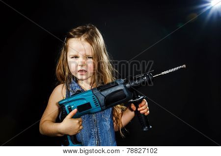 Cute Little Girl With Drilling Machine In Her Hands