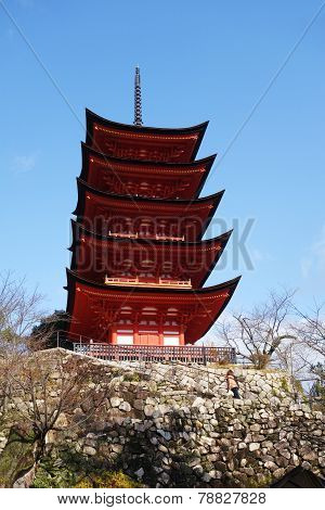 Miyajima Pagoda Located On The Red Hills Of The Island Of Miyajima.