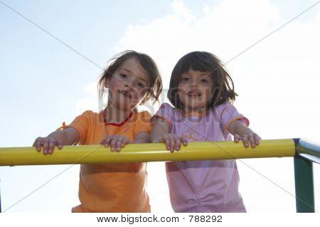 twins on climbing pole 01