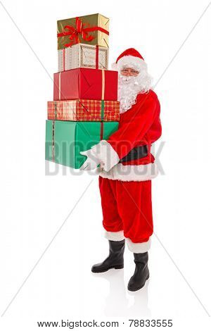 Father Christmas or Santa Claus holding a stack of gift wrapped presents with ribbons and bows, isolated on a white background.