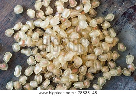 White Pomegranate Seeds On Wooden Table