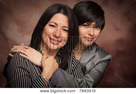 Attractive Multiethnic Mother And Daughter Studio Portrait
