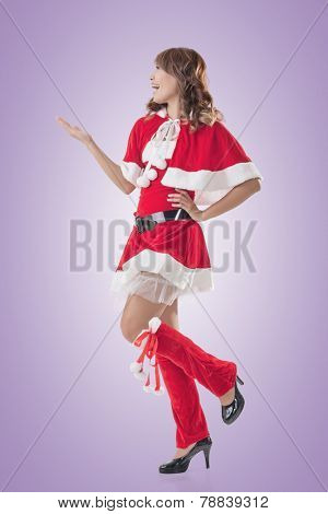Smile happy Asian Christmas girl introduce, isolated full length portrait.