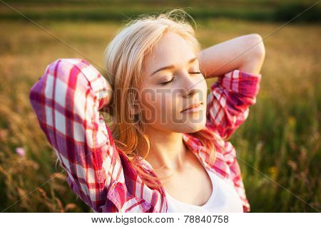 Happy Blonde Woman With Closed Eyes