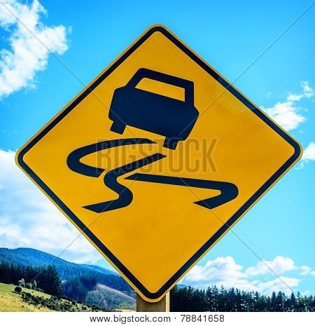 Yellow slippery road sign