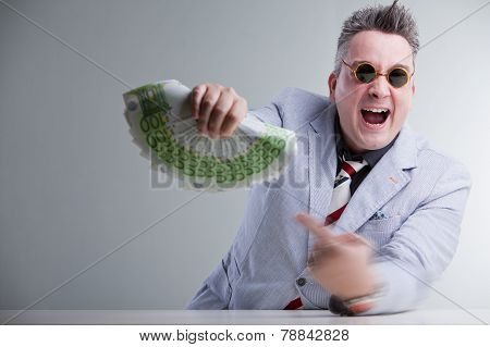 Man Pointig Banknotes In His Hand