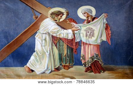 TRAVNIK, BOSNIA AND HERZEGOVINA - JUNE 11: 6th Stations of the Cross, Veronica wipes the face of Jesus  in the Church of St. Aloysius in in Travnik, Bosnia and Herzegovina on June 11, 2014.