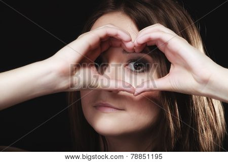 Teen Girl Doing Woman Heart Shape Love Symbol With Hands