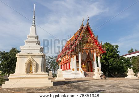 white pagoda and Temple at Wat Ban Ma