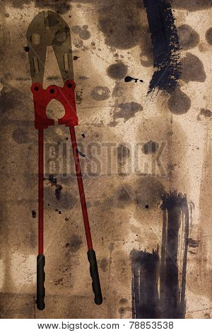Bolt Cutter On The Damaged Paper