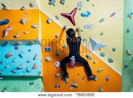Girl Climbing Up On Wall Indoor